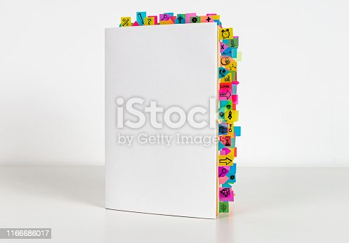 Business book and sticky reminders on the white background.