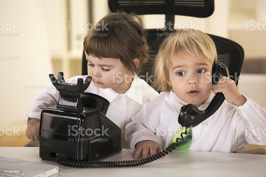 Business boy talking on the old phone stock photo