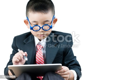 istock Business boy  with electronic tablet 135449409