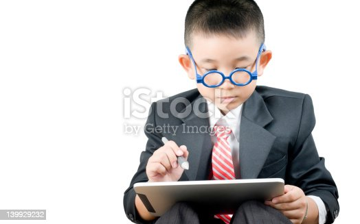istock Business boy with electronic tablet 139929232