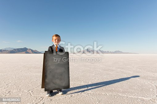 istock Business Boy with Sandwich Message Board 844638530