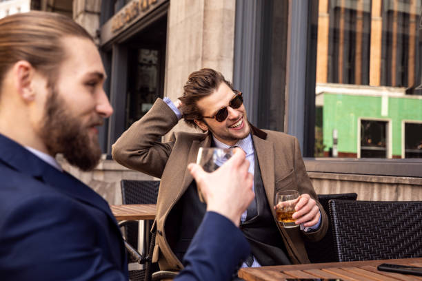 Business break - Two young businessmen taking a break in Central London Business break - Two young businessmen taking a break in Central London upper class stock pictures, royalty-free photos & images