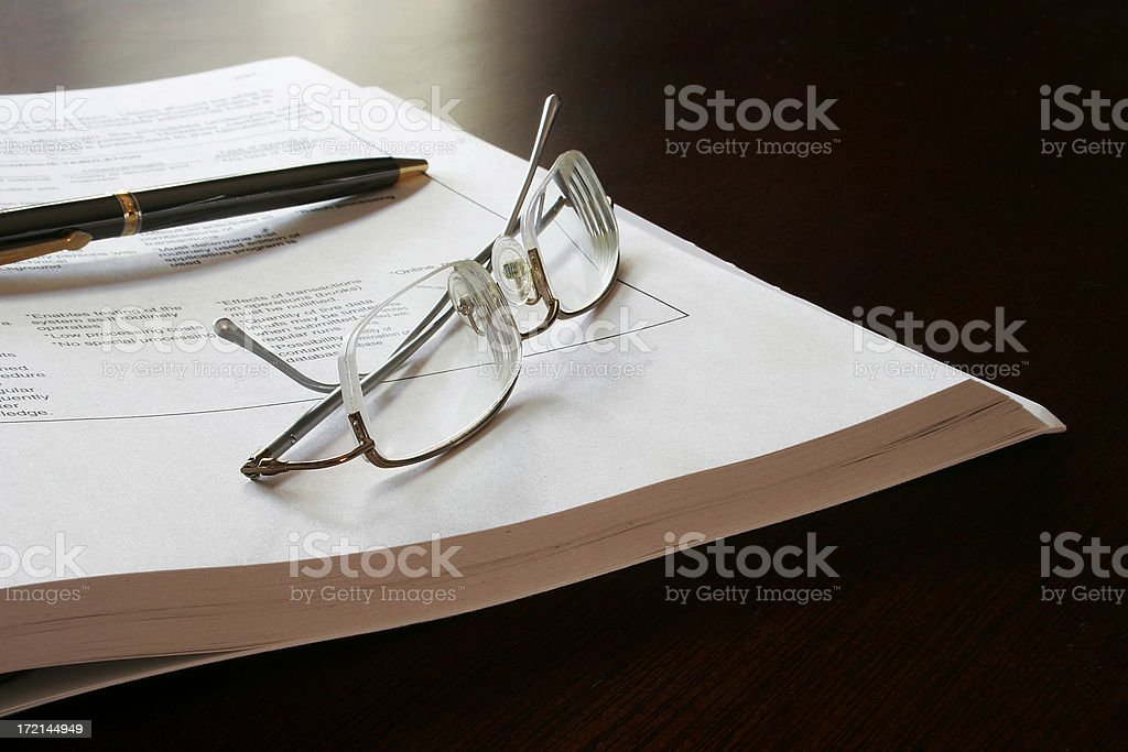 Business Brief, Glasses and Pen stock photo