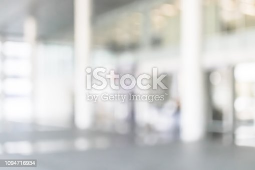 990877026 istock photo Business building, university or hospital blur background office lobby hall and corridor interior view of white room with blurry light from corridor glass window wall 1094716934
