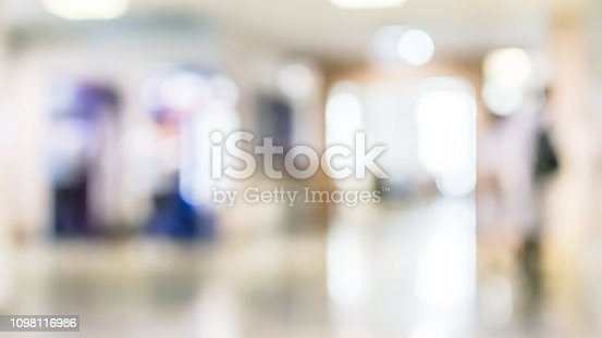990877026 istock photo Business building, university or hospital blur background office lobby hall and corridor interior view of white room with blurry light from corridor glass window wall 1098116986