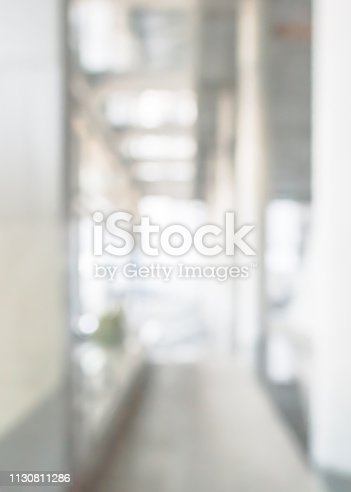 istock Business building, university or hospital blur background office lobby hall and corridor interior view of white room with blurry light from corridor glass window wall 1130811286