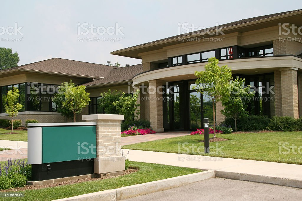 Business building with a sign on front lawn stock photo