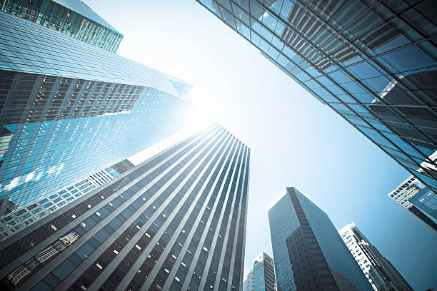 Business buildings Business buildings in New York - USA directly below stock pictures, royalty-free photos & images