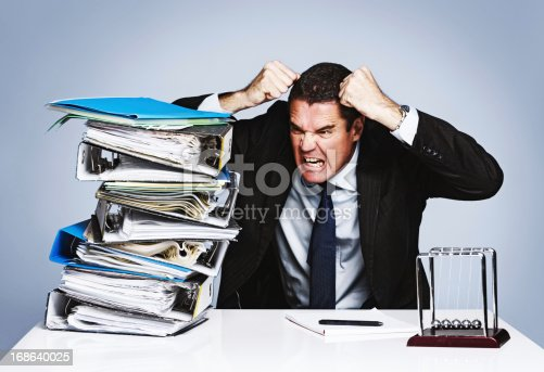 istock Business burnout for overworked businessman losing his cool completely 168640025