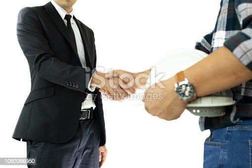1055059750 istock photo Business Businessman and engineer hand shaking hand Successful deal in isolated. 1092096950
