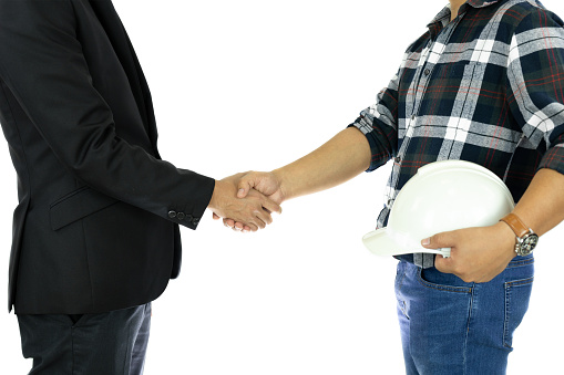912867216 istock photo Business Businessman and engineer hand shaking hand Successful deal in isolated. 1092097078