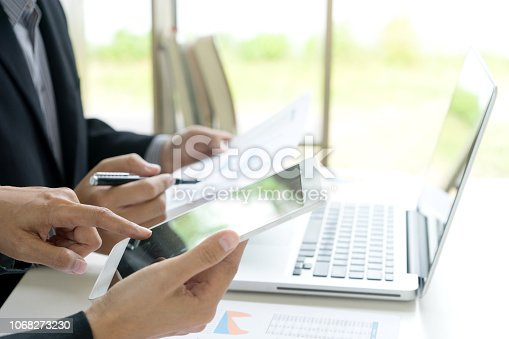 Business businessman work on the table use computer and tablet with graph chart of marketing analysis job.
