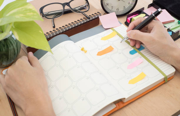 business calender planner meeting on desk office. organization management remind - timeline стоковые фото и изображения