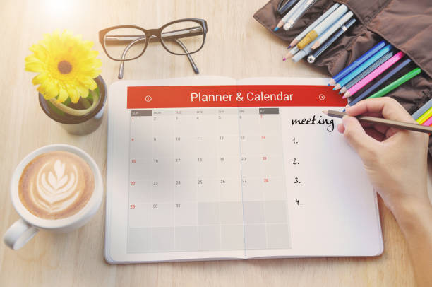 business calender planner meeting on desk office. - timeline visual aid stock photos and pictures