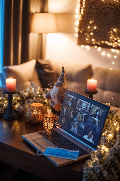 Business calling on a Home Office Set Up for Webinar and Teleconference at Christmas lockdown stock photo