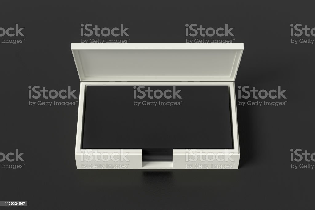 White leather business card box holder with black business cards in...