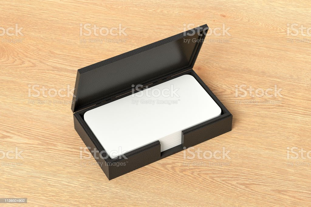 Black leather business card box holder with blank business cards with...