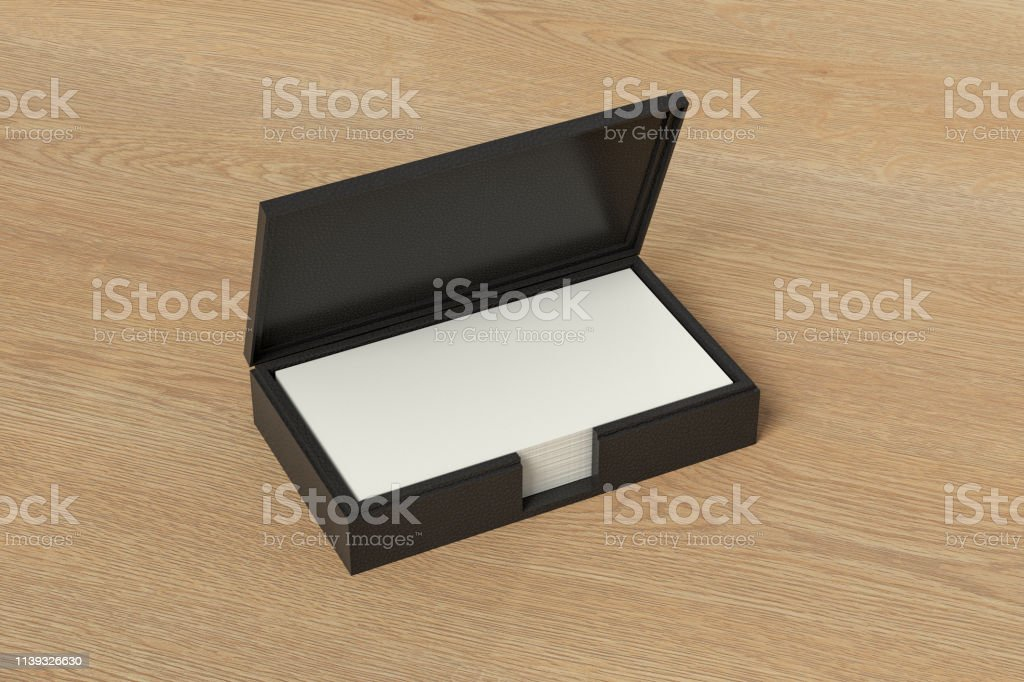Black leather business card box holder with blank business cards in...