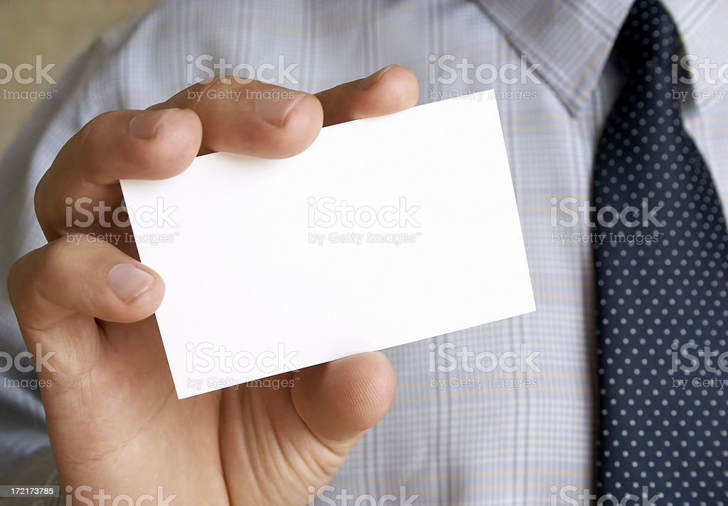 Business card in a hand royalty-free stock photo