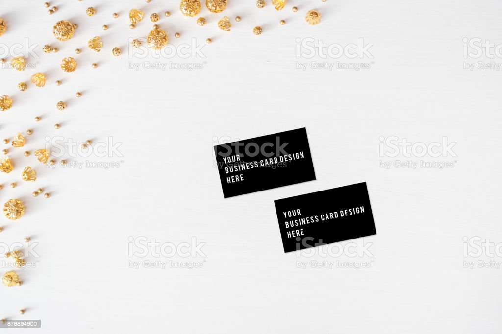 Business card mockup Christmas composition background. wallpaper, pine cones, decoration balls, on white background. Flat lay, top view stock photo
