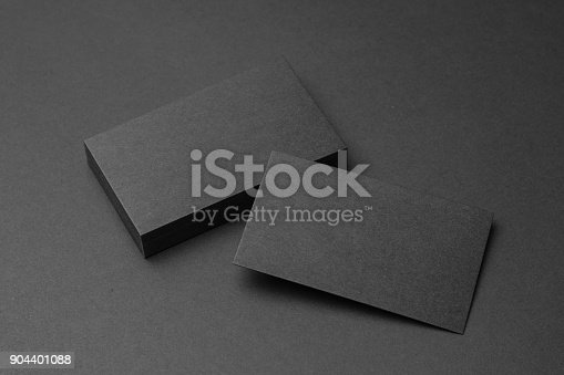 1144802544 istock photo Business card on black background 904401088
