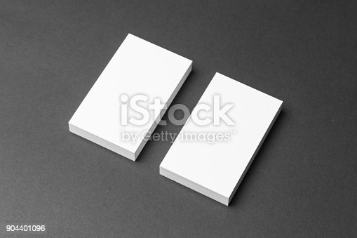1144802544 istock photo Business card on black background 904401096