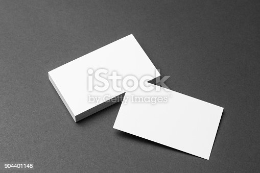 1144802544 istock photo Business card on black background 904401148