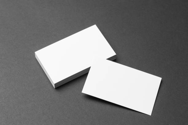 business card on black background - business card stock photos and pictures