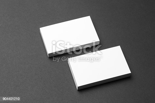 1144802544 istock photo Business card on black background 904401210