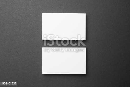 1144802544 istock photo Business card on black background 904401338