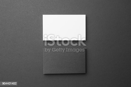 1144802544 istock photo Business card on black background 904401402