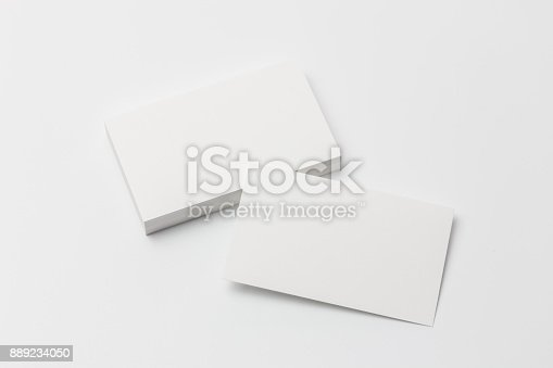 1144802544 istock photo Business card on white background 889234050