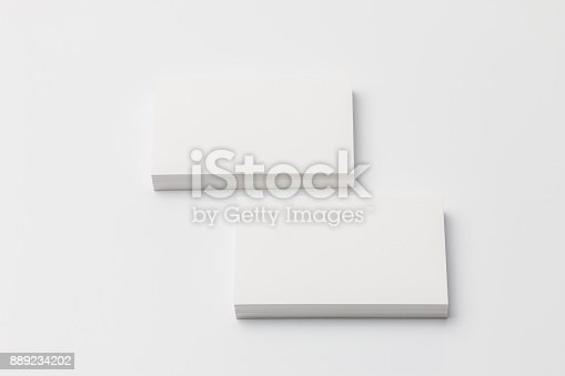 1144802544 istock photo Business card on white background 889234202