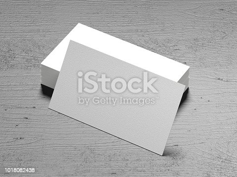 1144802544 istock photo Business card on wood background 1018082438