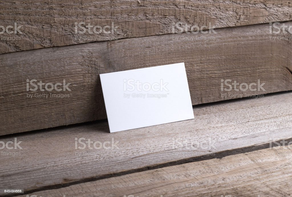 Business cards isolated on old wood background stock photo