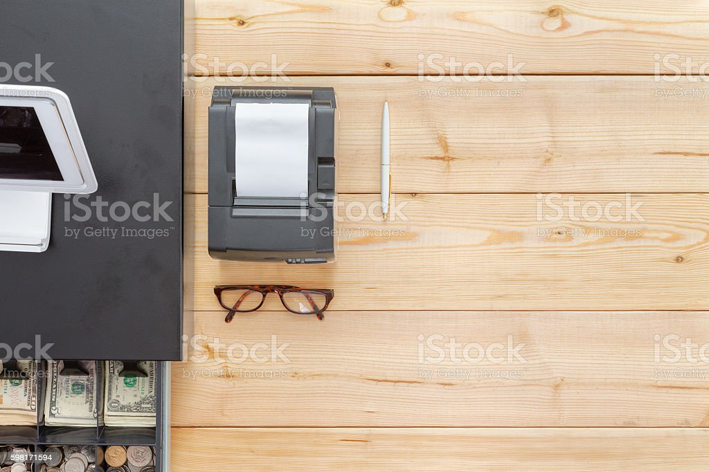 Business cash register on a clean desk stock photo