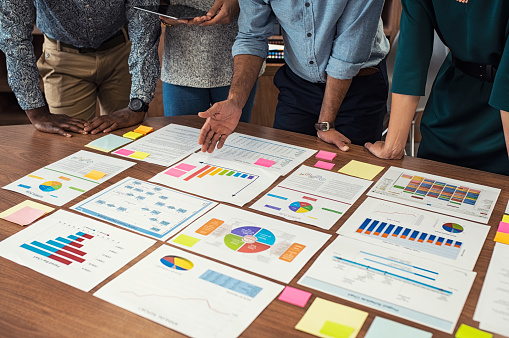 Business Casual Team Working On Graphs Stock Photo - Download Image Now