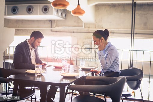 Business lunch. Business partners meeting at the restaurant. Young businisswoman and businessman at the lunch break