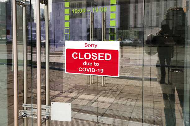 Business center closed due to COVID-19, sign with sorry in door window. Stores, restaurants, offices, other public places temporarily closed stock photo