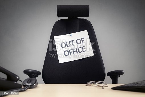 istock Business chair with out of office sign 684823218