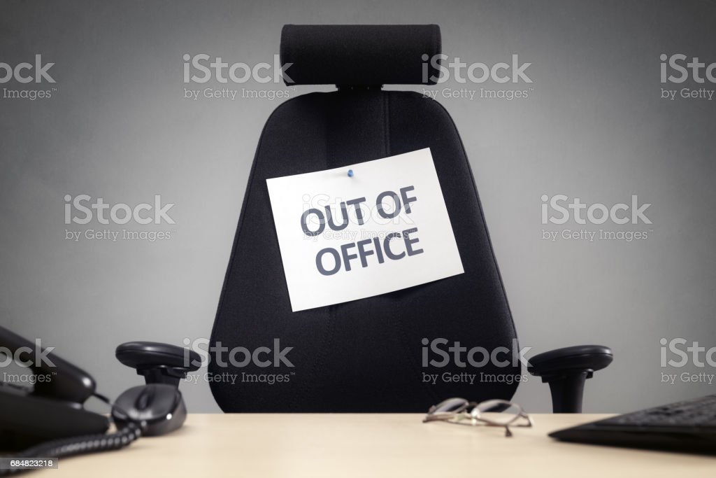 Business chair with out of office sign stock photo