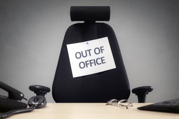 Business chair with out of office sign - foto stock