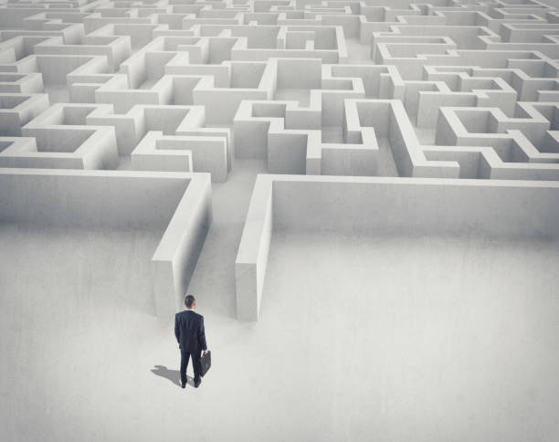 business challenge. a businessman navigating through a maze. top view - maze stock photos and pictures