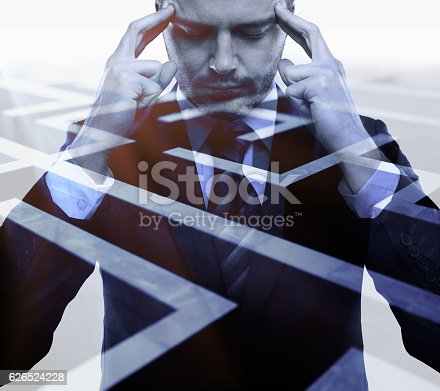 Pensive young businessman on abstract maze background. Business challenge concept. Double exposure