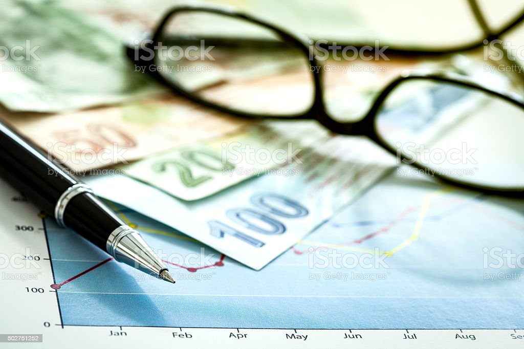 Business chart and eyeglasses stock photo