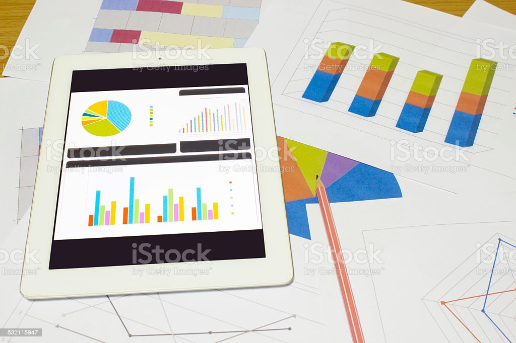Business chart and graphs on paper stock photo
