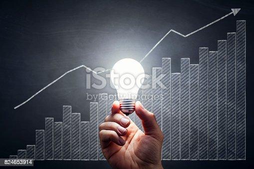 istock Business Chart - Light Bulb Hand Idea Blackboard Chart Diagram 824653914