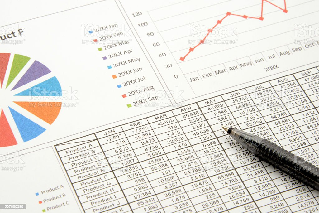 Business charts and pen stock photo