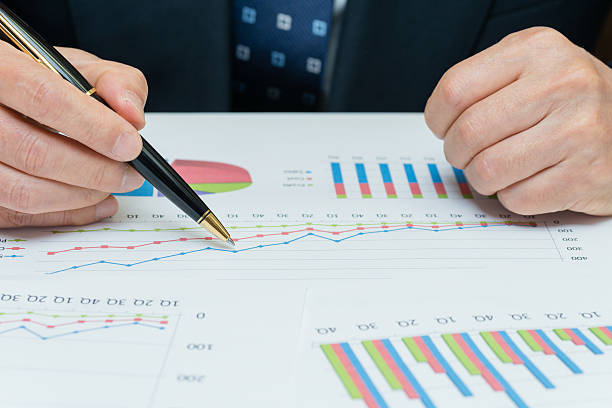 Business charts being reviewed by executive (XXXLarge) stock photo