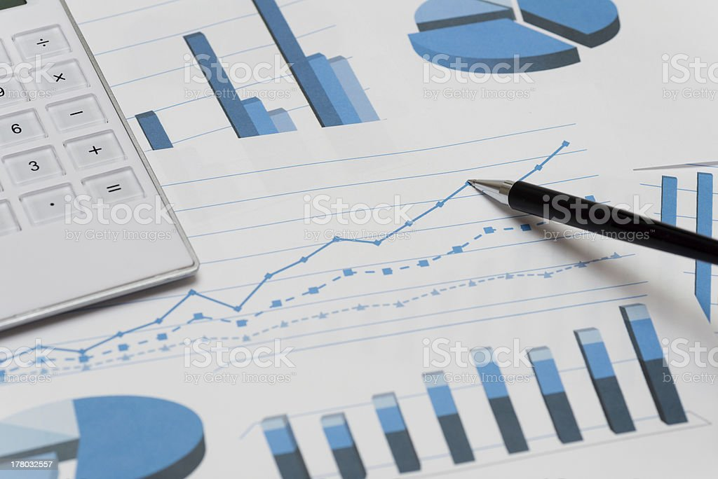 Business charts with ballpoint pen and calculator (XXXLarge) stock photo